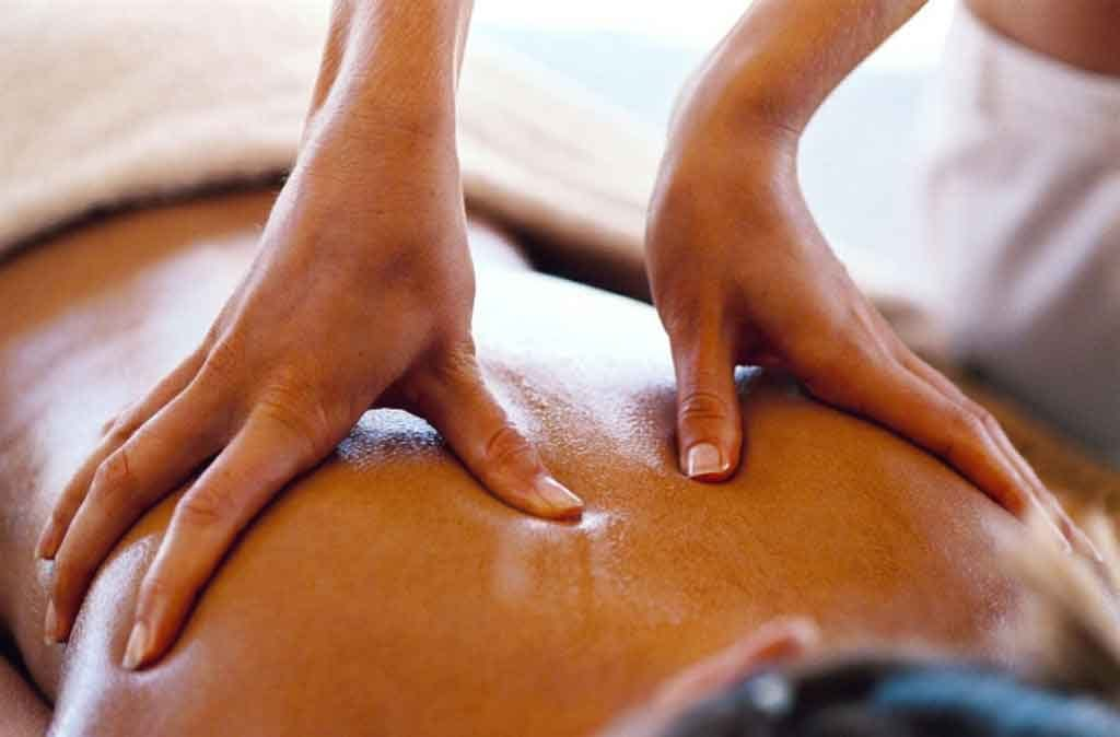 Massage therapist working with a client