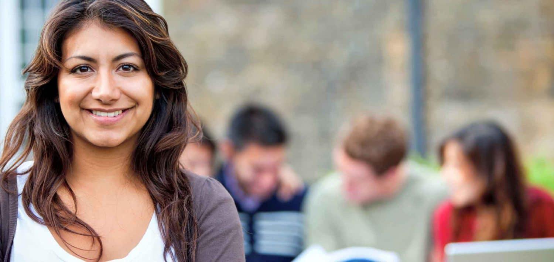 Female student smiling outside.